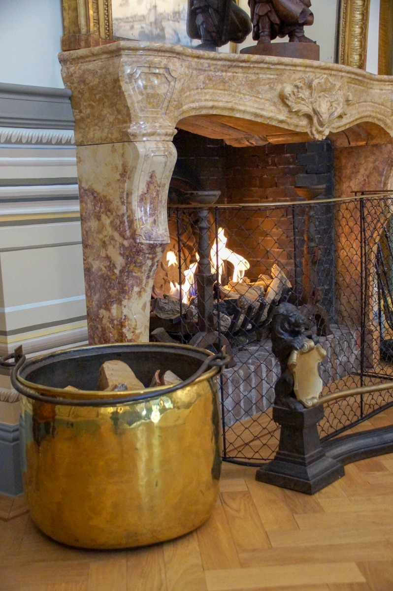 Burning fireplace with fireplace accessories