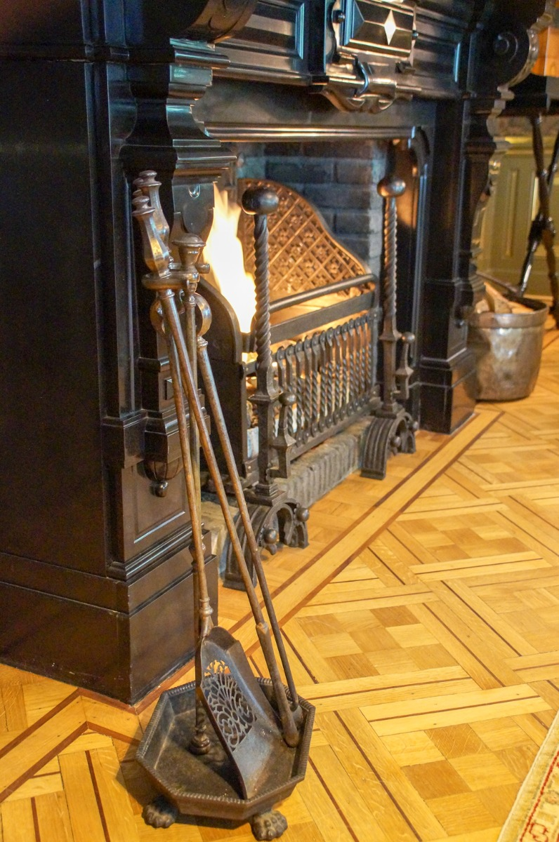 Gas fireplace decorated as wood-burning fireplace with a fireplace grate