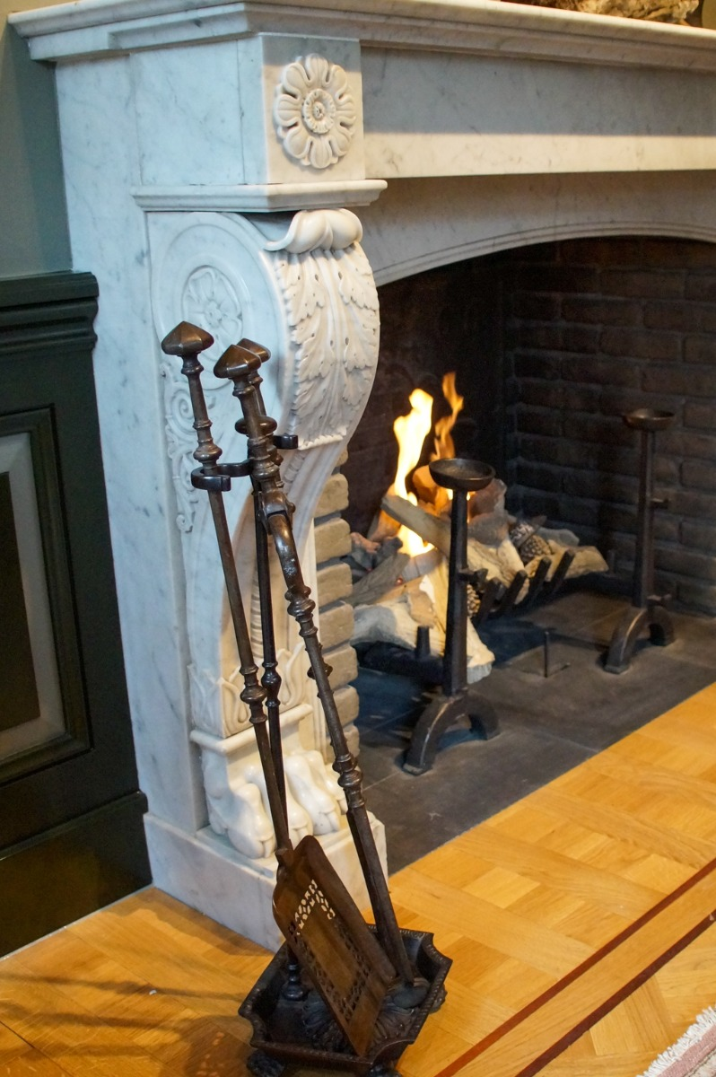 Antique fireplace with fireplace accessories