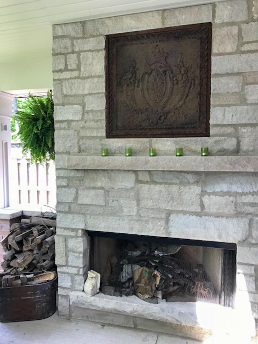 Fireback in outdoor fireplace in Ontario, Canada sourced from https://www.firebacks.net