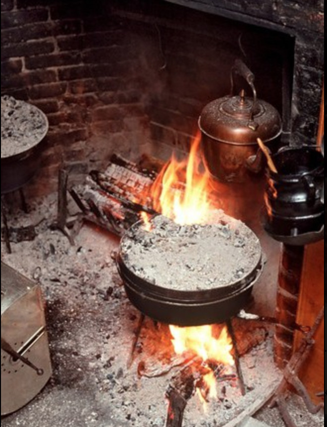 Dutch oven in an open fireplace