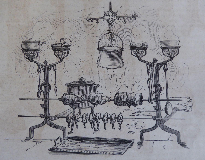 Foyer de cuisson avec des outils de cheminée antique
