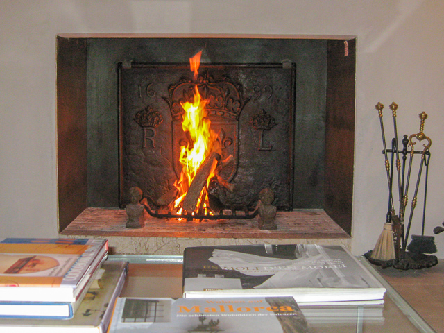 Modern fireplace nicely decorated with antique fireplace accessories