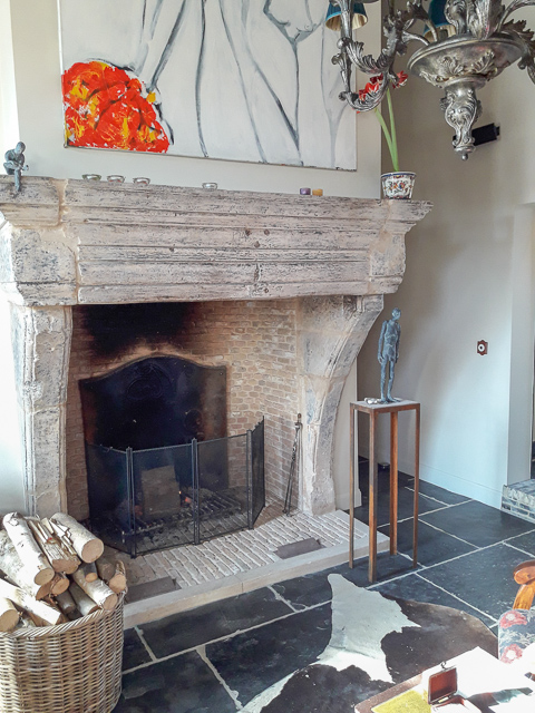 Nicely decorated fireplace with antique fireplace accessories