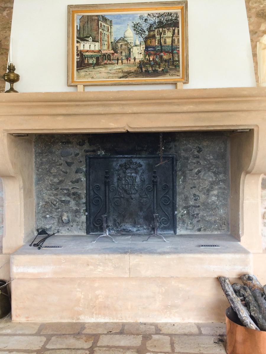 Fireback in fireplace in the Provence, France sourced from https://www.firebacks.net